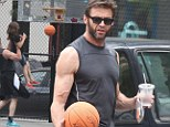 White men can jump: Hugh Jackman scores a slam dunk playing basketball in NYC