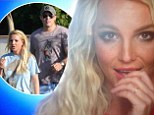 Ooh la la, indeed! Britney Spears tweets music video still flaunting curious silver band on her ring finger
