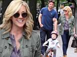 Her little tike on a bike! Jane Krakowski and husband Robert Godley fawn over cycling son Bennett