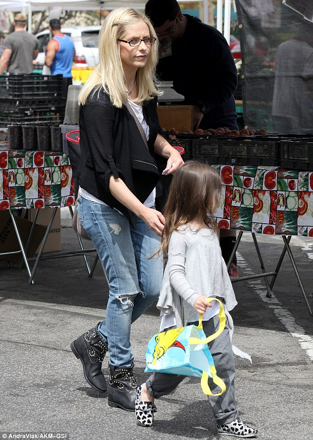 Mommy's little helper: Charlotte took hold of a reusable shopping bag to assist her mother