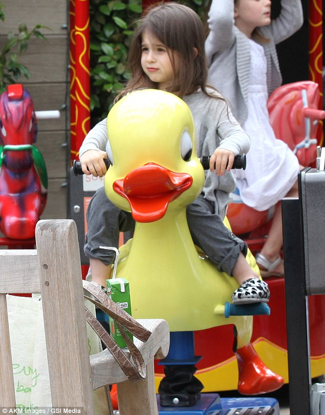 Ducky ride: The sweet girl appeared to enjoy her ride on the mechanical bird