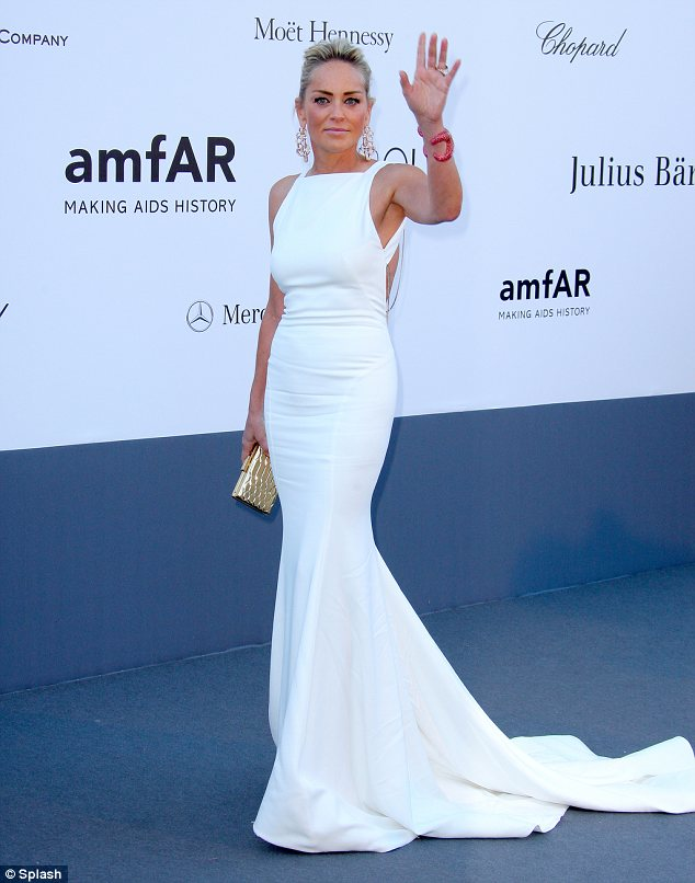 Show-stopping: Sharon looked every inch the star in a dazzling white Roberto Cavalli gown at the 20th Annual Cinema Against AIDS Gala in Cannes