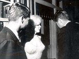 'Passed around': President John F Kennedy and his brother Bobby (left) with Marilyn Monroe