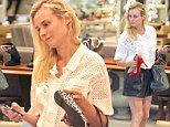 The girl knows her shoes! Diane Kruger contemplates Neiman Marcus' assortment as she sports leather shorts