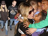 How cute are they!? Heidi Klum's kids gathered for a group hug as they saw their mother off at LAX on Friday
