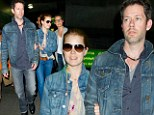 Denim jet setters: Amy Adams and her fiancé Darren Le Gallo don matching jean jackets for six-hour flight to New York