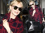 Can I get a hand? Carey Mulligan is nearly weighed over as she plays the role of bag lady at LAX