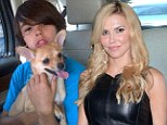 New dog: Brandi Glanville and her son Mason welcome home a new dog Chico while the search goes on for missing Chihuahua Chica