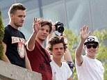 Where's Zayn: The fifth member of the band didn't seem to want to come out out the roof with the others as their was no sign of him