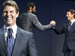 The Top Gun and the Wolverine! Tom Cruise and Hugh Jackman shake hands at Wal-Mart event