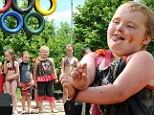 Now she's an Olympian! Honey Boo Boo hits the winner's podium at the 2013 Redneck Olymp-Hicks with some mud sliding and belly flopping in Georgia