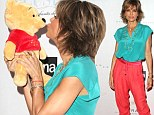 Pucker up! Lisa Rinna has a red carpet moment in Los Angeles Sunday with a stuffed bear