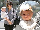 Upstaged by a feather! Kourtney Kardashian's little showgirl Penelope steals the spotlight in flashy headband on mother-daughter shopping trip