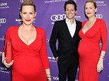 Pregnant AND sexy! Alice Evans heats up the red carpet in a bump-revealing red dress alongside husband Ioan Gruffudd