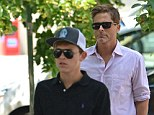 Similar: The father and son looked very similar as they strolled along very much in sync with each other