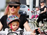 Pink and her daughter Willow enjoy a bike ride at Venice Beach, California on Sunday
