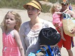 We need a beach day! Amy Adams plays in the sand with daughter Aviana and fiancé Darren Le Gallo