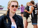 Young love: Ireland Baldwin and Slater Trout are spotted kissing one another on Santa Monica Beach