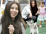 Roselyn Sanchez and husband Eric Winter dote on their little girl Sebella at farmer's market