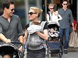 They've got their hands full! Anna Paquin juggles the twins while husband Stephen Moyer is loaded up with shopping bags for family outing