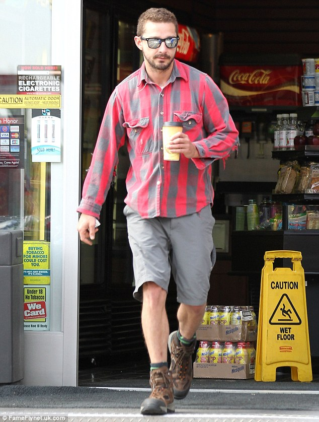 Even action stars need coffee: Shia looked pleased to finally have the take-out drink in his mits