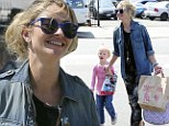 Here comes the mum! Rebecca Gayheart is in high spirits as she picks daughter up from school