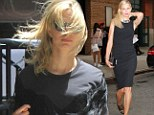 Even supermodels have bad hair days! Karolina Kurkova looks less than her best on windy outing after a sleek red carpet turn