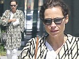 Make-up free Minnie Driver drowns her curves in unusual sweater coat for lunch date with a friend