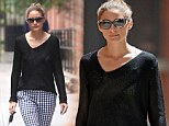 Olivia Palermo's holey sweater reveals skimpy white crop top as she stalks around the Big Apple