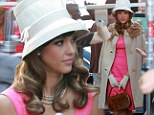 Straight out of the 1960s! Jessica Alba goes from bathing beauty to first lady material with the change of a hat