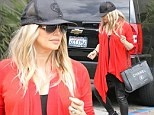 The big bump cover up: Fergie hides her heavily pregnant frame in flowing red cardigan