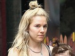Is that you, Sienna? Miller takes her sunglasses off to reveal a make-up free face with pale skin and tired eyes