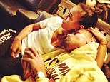 Back on again then? Chris Brown looks like he's back in the arms of on/off girlfriend Karrueche as they pose for a cosy picture cuddling up together tenderly