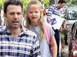 Back on the road! Ben Affleck proudly carries his daughter Violet's artwork as he picks her up from school... in the same car that broke down only yesterday