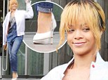 Rihanna dons heels and dungarees in Manchester, England