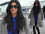 The downside of shoulder-robing! Nicole Scherzinger hands disappear underneath her coat as she arrives for X Factor auditions