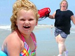 It's Mama June-watch! Honey Boo Boo's mother has a Pamela Anderson moment as family spend a day at the beach