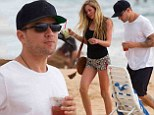 It must be love! Ryan Phillippe whisks his gorgeous young co-ed to Hawaii for romantic getaway