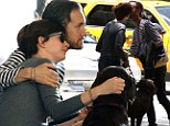Still in newlywed bliss! Anne Hathaway and Adam Shulman steal a kiss while walking their dog