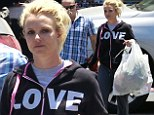 Flower power! Make-up free Britney Spears goes casual in LOVE sweat jacket to load up on artificial blooms