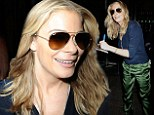 She's holding up well! LeAnn Rimes smiles while promoting new album Spitfire despite dismal sales figures