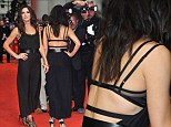 Sandra Bullock flashes her bra in backless dress at London premiere of The Heat