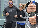 Perfectly in sync! Heidi Klum and boyfriend Martin Kristen profess their love with matching gold rings on morning jog