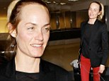 She doesn't need it! Make-up free Amber Valletta shows off her flawless complexion as she jets into LAX