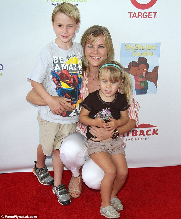 Working mother: With her kids at the 3rd Annual My Brother Charlie Family Fun Festival last August