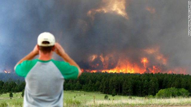Schad Dohl watches a wall of fire as it rages through the Black Forest near Colorado Springs on Wednesday, June 12.