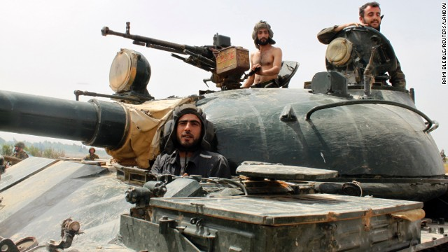 Forces loyal to Syrian President Bashar al-Assad are seen near Qusayr on Thursday, May 30.