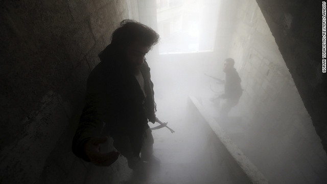 Free Syrian Army fighters walk through a dust-filled stairwell in Damascus on February 7.