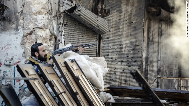 A rebel fighter fires at a Syrian government position in Aleppo on November 6.