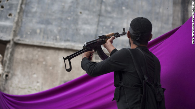 A Syrian rebel fires at an army position in the Karm al-Jabal district of Aleppo on October 22.